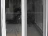 white-double-retractable-door-open